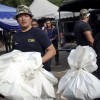 Malaysian police begin exhuming bodies at jungle camps