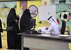 Some Qatari's spend two hours waiting to cast ballot, despite predictions of a small turnout